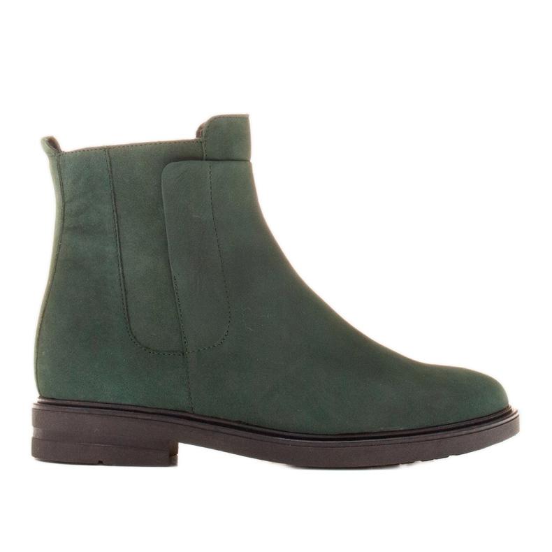 Marco Shoes Botas ligeras aisladas con fondo plano de piel natural verde
