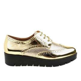 Zapatos TL-60 dorados con cordones amarillo