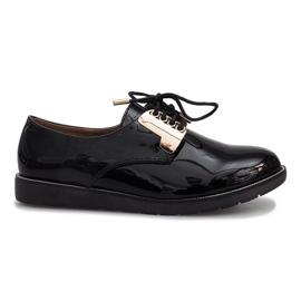 Zapatos Rose lacados en negro