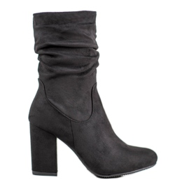 Kayla Botas altas en un poste negro