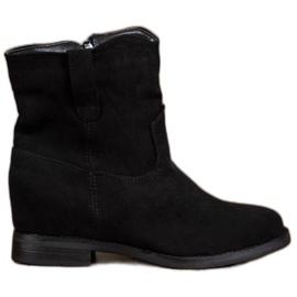 Ideal Shoes Botas vaqueras calientes en cuña negro