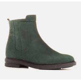Marco Shoes Botas ligeras aisladas con fondo plano de piel natural verde 1